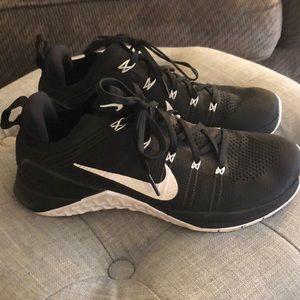 Black and white Nike Metcons